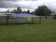 Build a sandpit under the purple shade sail